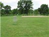 isc golf stand with volleyball court in background
