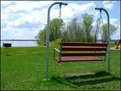 Image of a bench swing in a park