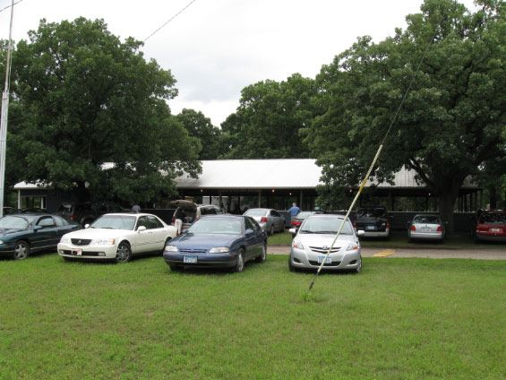 Cars parked in lot for large picnic shelter