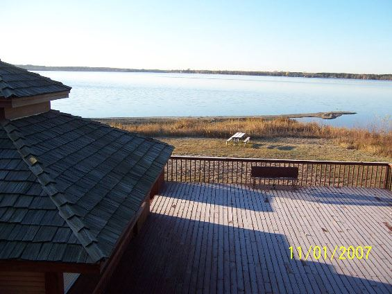 Image from second floor of wooden deck and lake