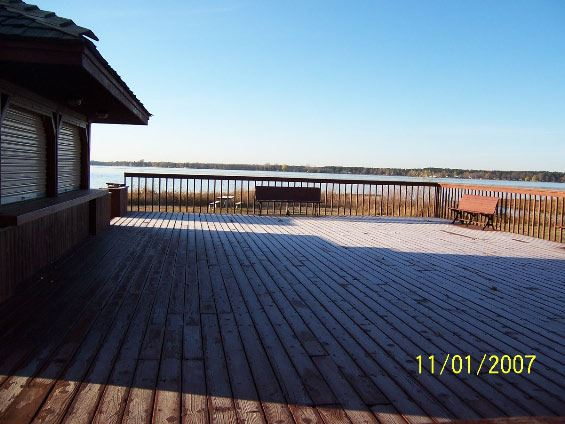 Image of woden deck and lake in background
