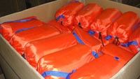Box of Orange Inflatable Sandbag Kits