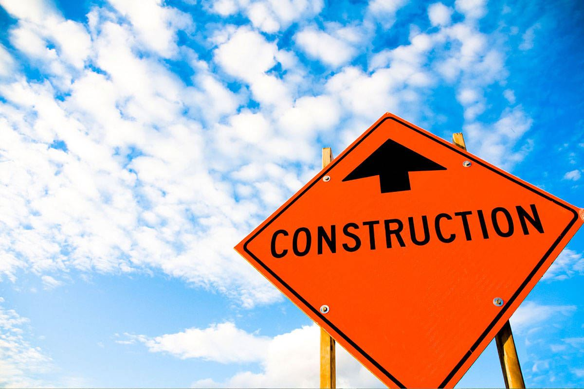 Construction Sign with Sky Background