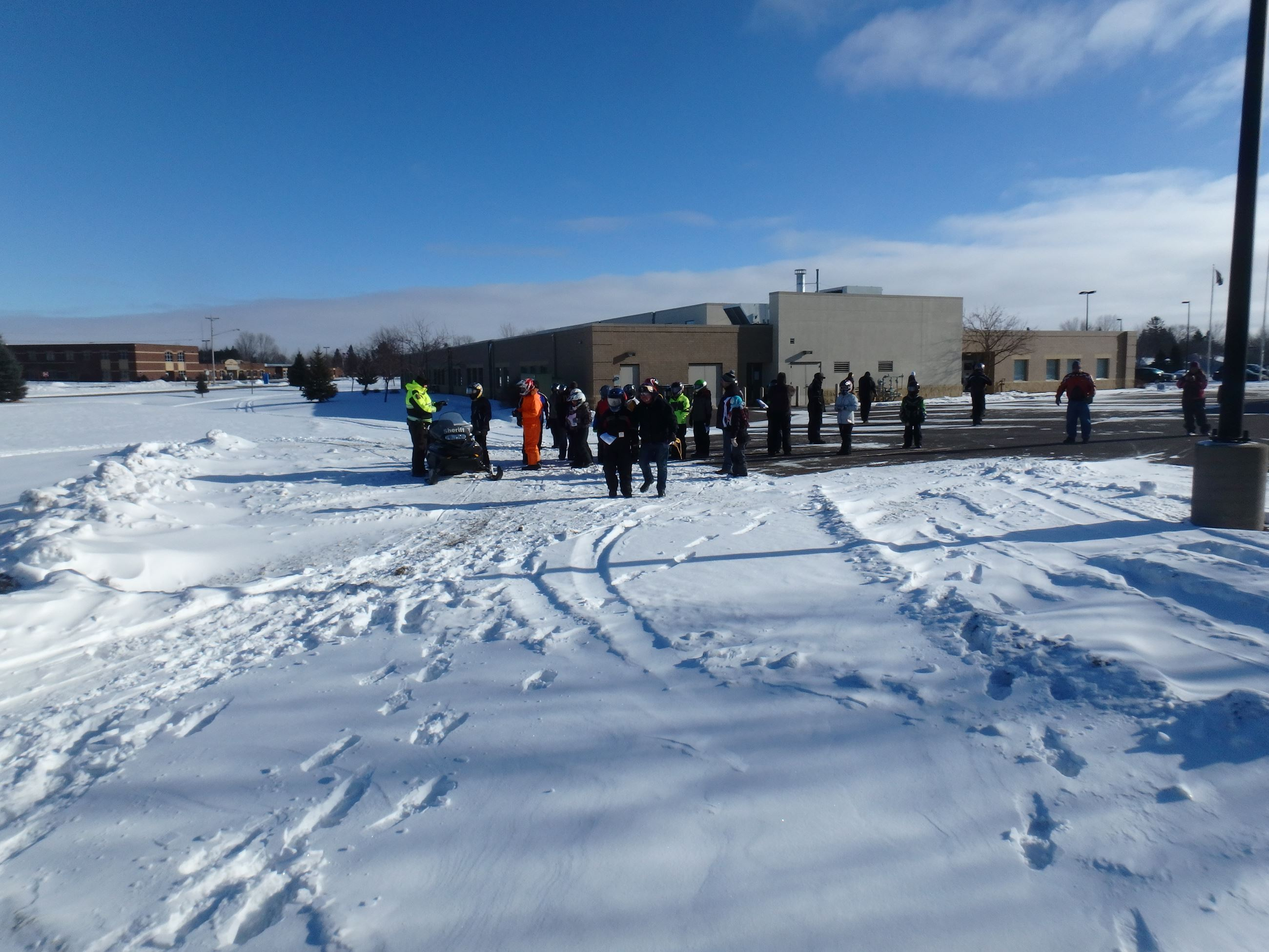 Youth snowmobile safety class participants receiving instruction