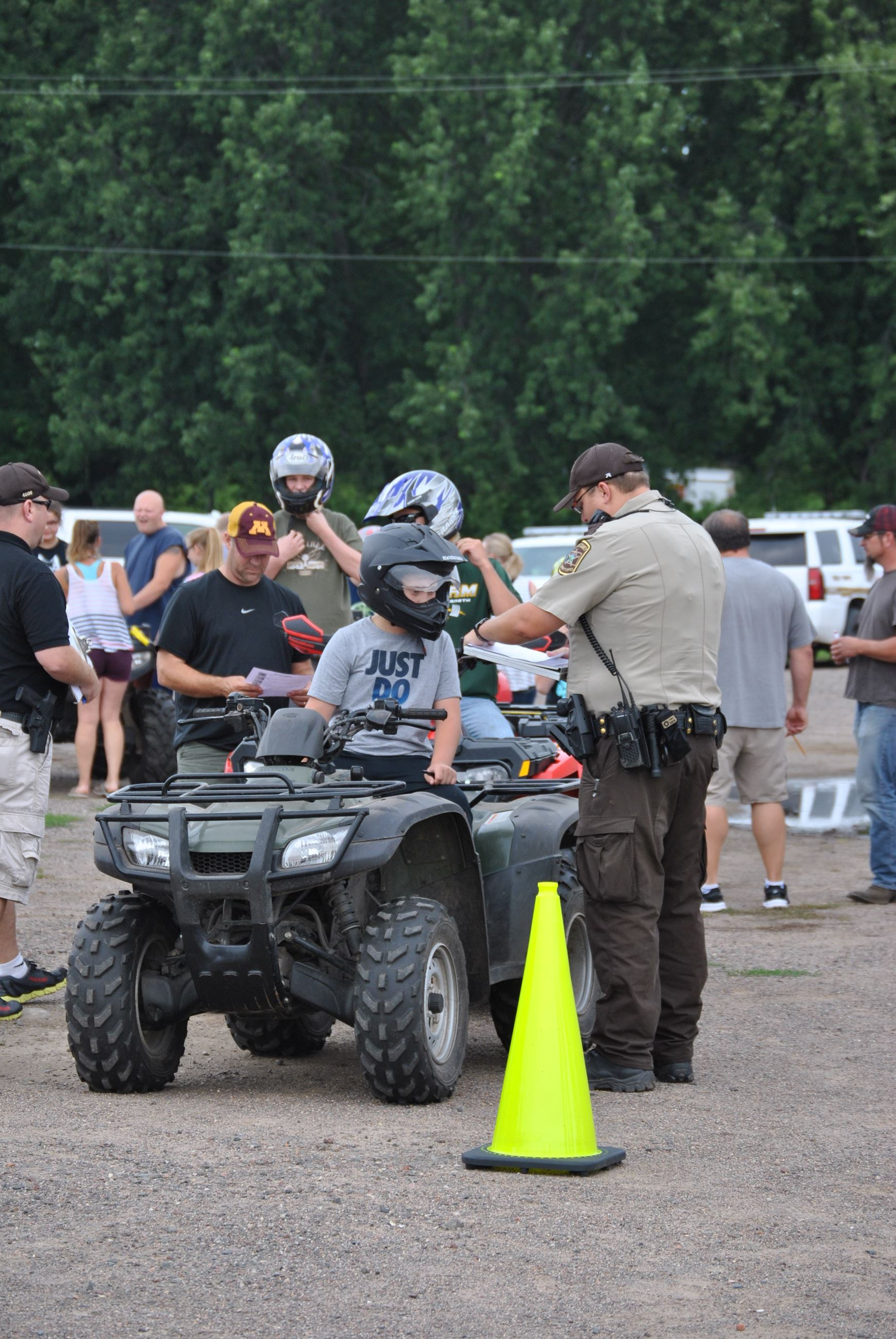 Youth on ATV with deputy